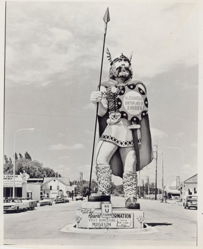 After the World's Fair ended, Big Ole was welcomed to his permanent home in Alexandria, MN. He was placed on a pedestal on the north end of Broadway Street on December 21, 1965. Notice that the text on his shield was changed. Here he greeted visitors and residents for decades. Photo courtesy of Douglas County Historical Society.