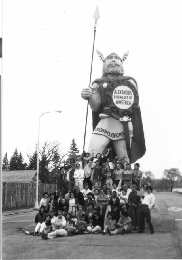 Old pic of the Rotary Youth Exchange posing with Big Ole while he was directly in front of the Runestone Museum. How many thousands (maybe millions?) of people have posed with our Viking king over the years!? Photo courtesy of Douglas County Historical Society.