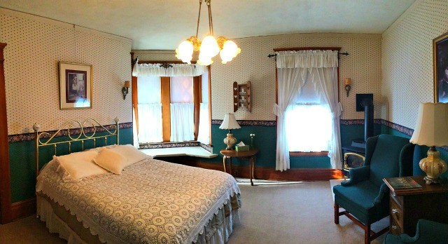 The Alma Anderson room has a cozy bay window seat and features a spacious French Thermo-Masseur whirlpool in a clawfoot tub with stand-up shower!
